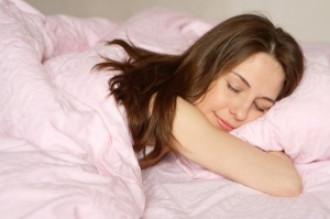 woman-happy-sleeping-pink-bed1